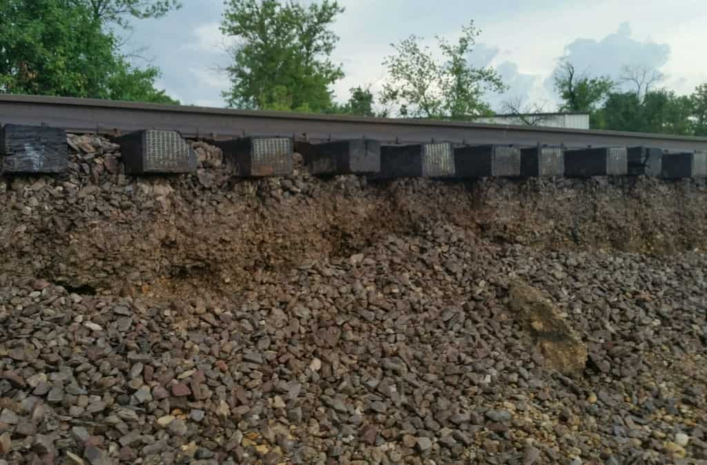 Flooding washed out the ballast supporting these Metra tracks on the Milwaukee District North line near Illinois 120, north of Libertyville, Wednesday morning. Service was halted in both directions. | Metra photo
