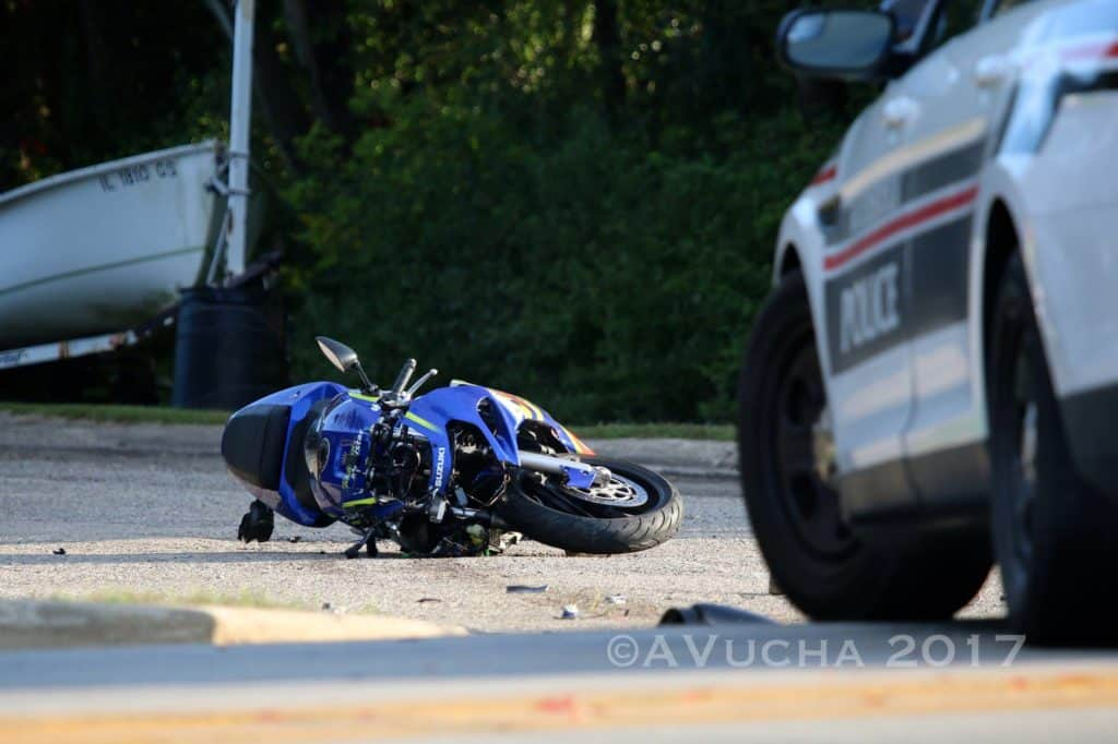 Motorcyclist critically injured after driving in opposite lanes of traffic, striking car in Woodstock