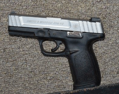 Police officers recovered a loaded 9mm semi-automatic handgun that was stolen