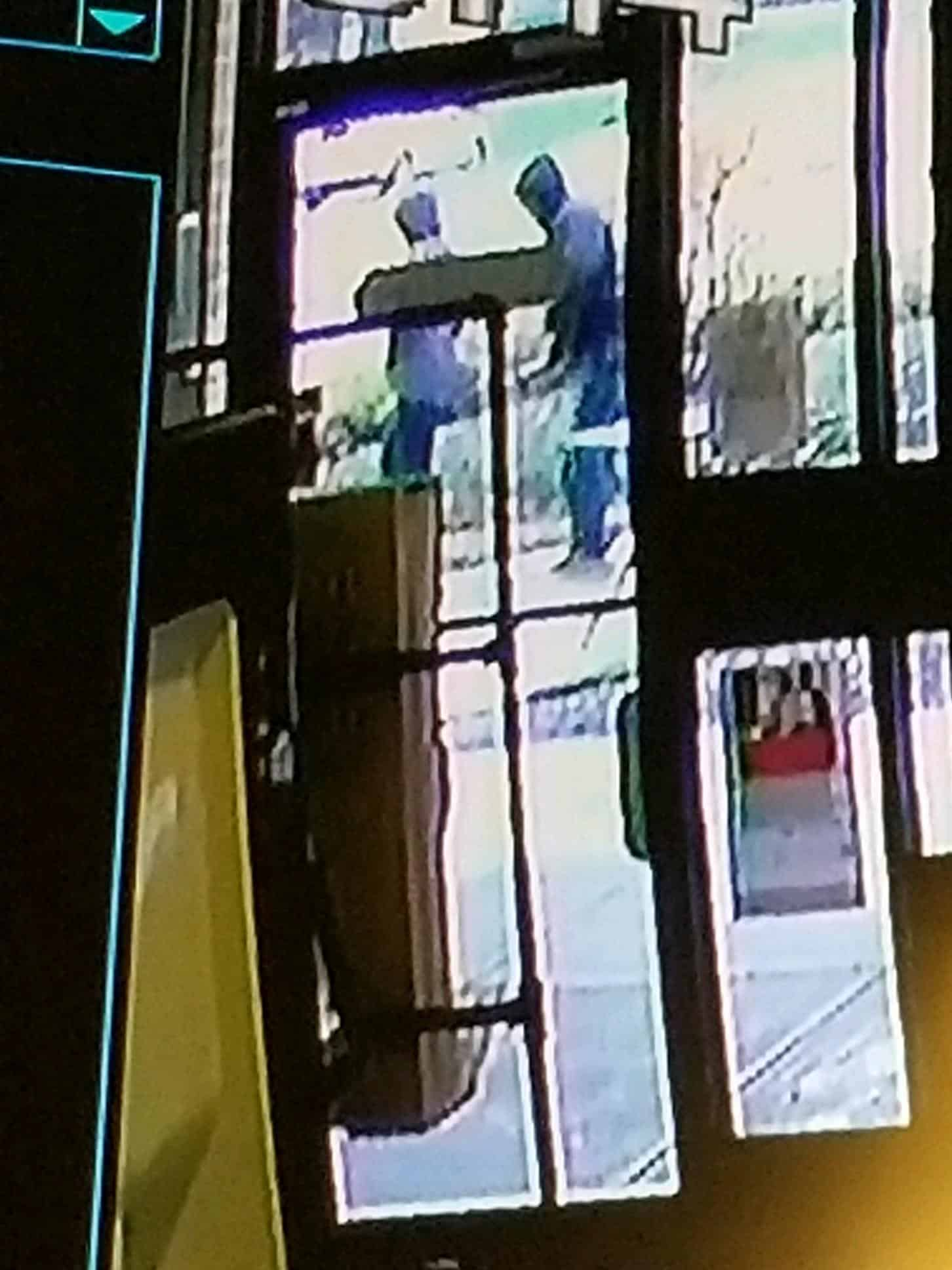 Surveillance footage of the attempted armed robbery (suspect on the right)