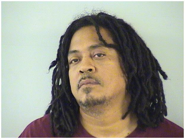 Felon arrested after three guns, marijuana found in North Chicago home
