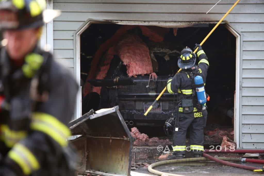 Explosion that caused garage fire in McHenry under investigation