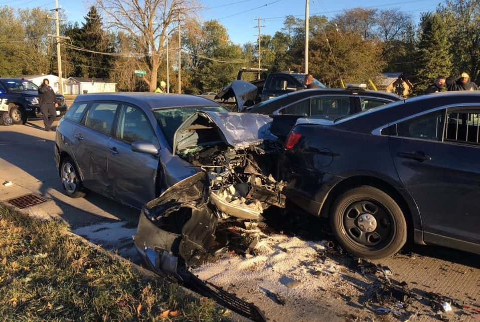 2 injured after drunk driver slams into two police cars in McHenry
