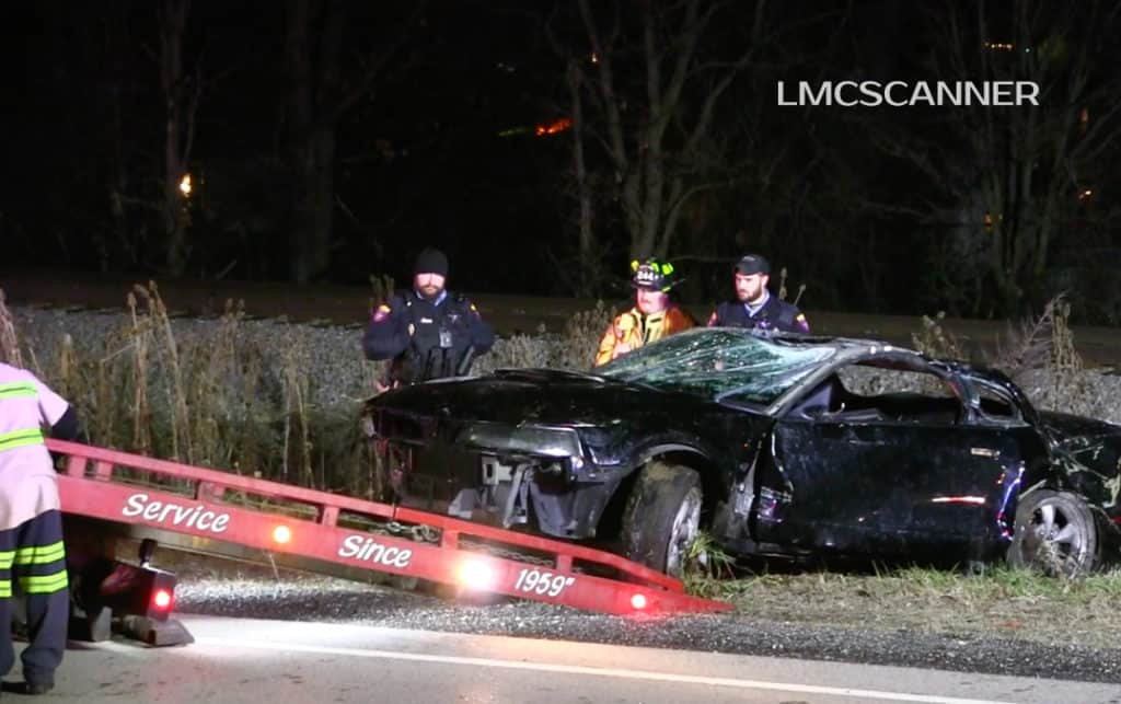 Car loses control, rolls over near railroad tracks in Round Lake