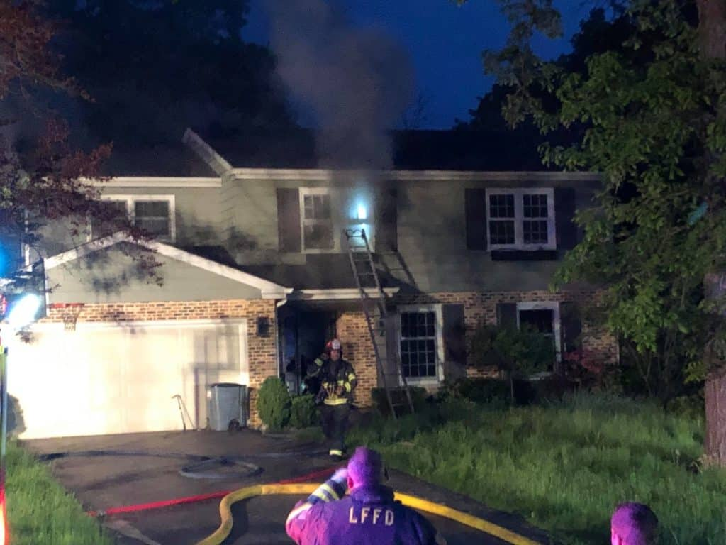 Firefighters rescue woman from roof of burning home in Lake Forest