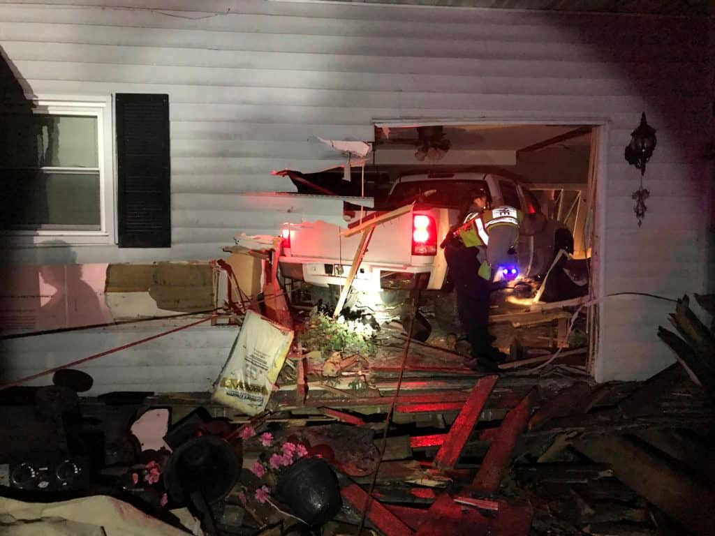 Pickup truck slams into Spring Grove home, pinning sleeping 71-year-old woman under truck