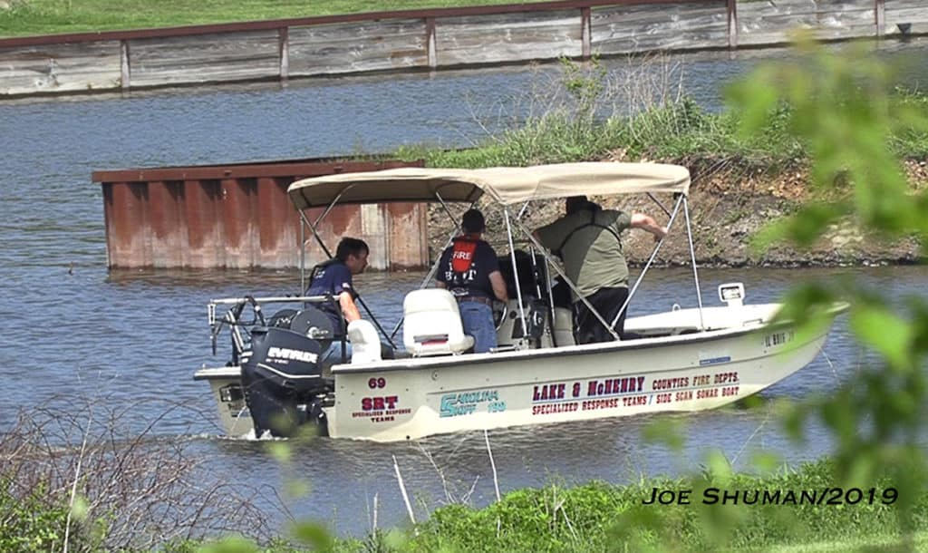 Divers search water for Fox Lake man missing since early May