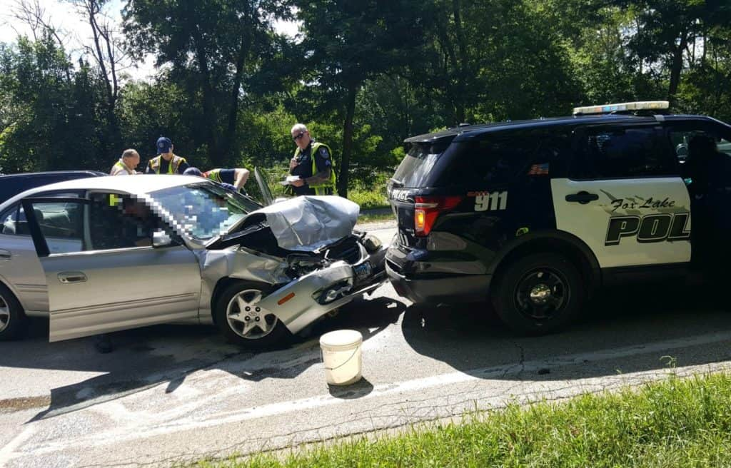Police officer, woman hospitalized after car crashes into rear of police car in Fox Lake
