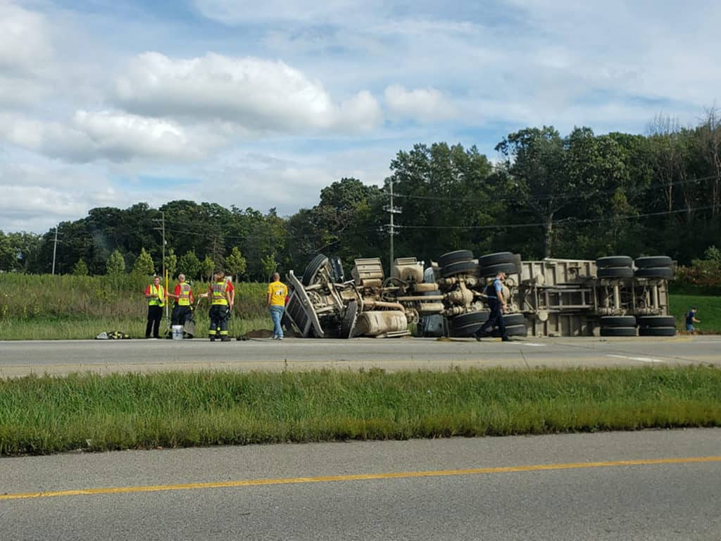 All lanes of Route 12 shut down after 18-wheeler rolls over in Volo