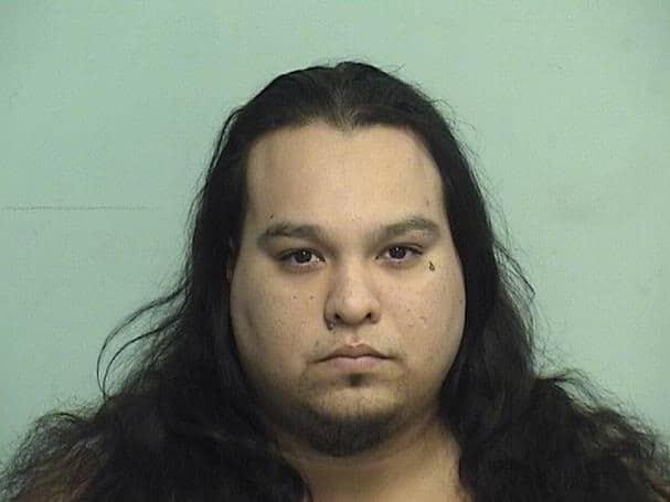 Gang member arrested after police find guns, drugs at North Chicago home