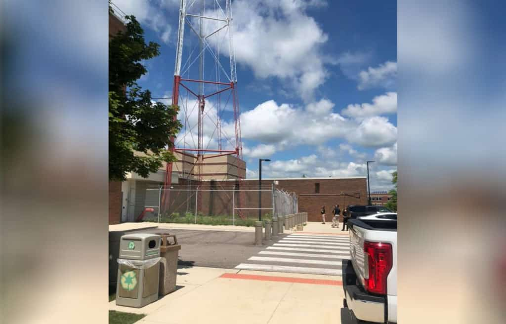 Man detained after climbing up radio tower in Woodstock