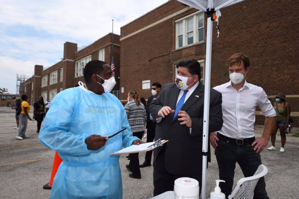 Gov. J.B. Pritzker calls for national face-covering requirements