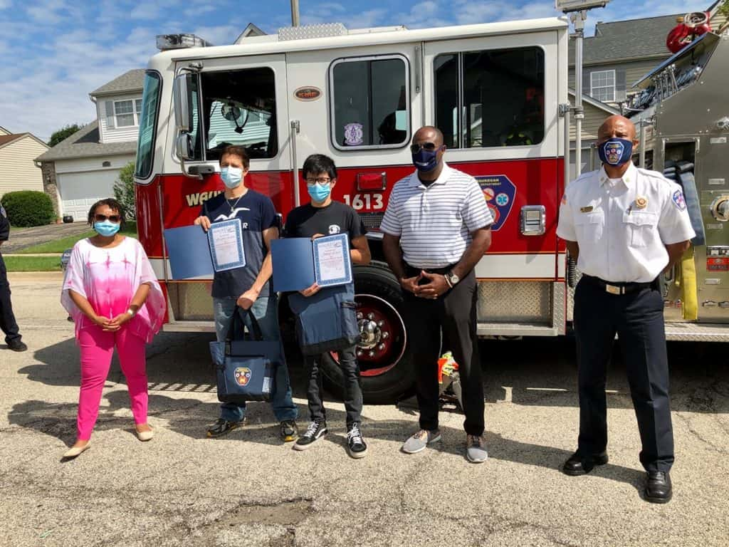Father, son awarded for saving neighbors during house fire