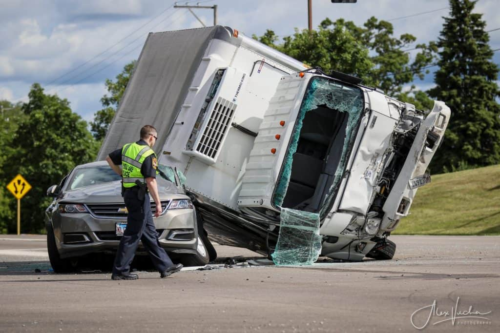 1 in critical condition after box truck rolls over onto car in Crystal Lake