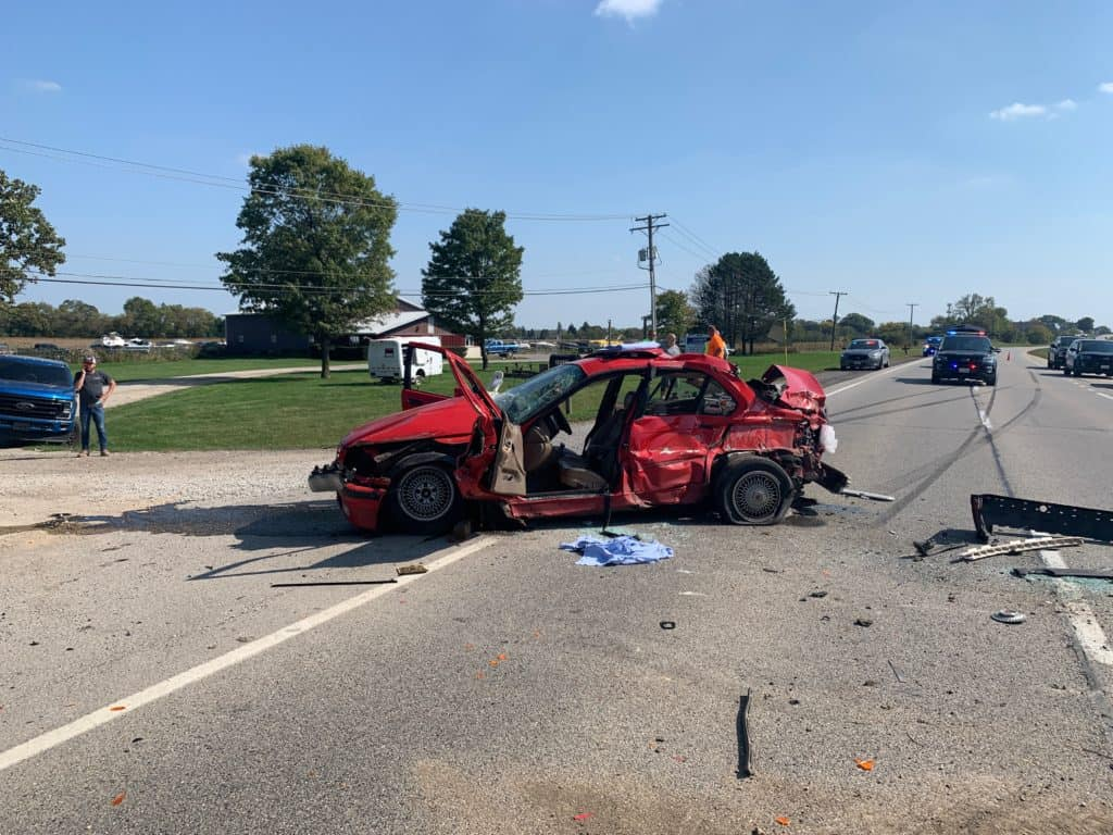 19-year-old woman dies following crash with BMW, dump truck in Wauconda
