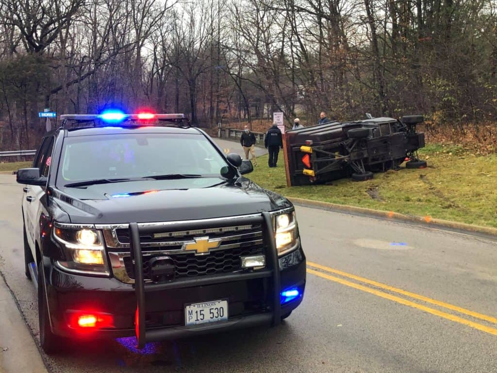 Driver hospitalized after being pinned under rolled over utility vehicle in Lake Forest