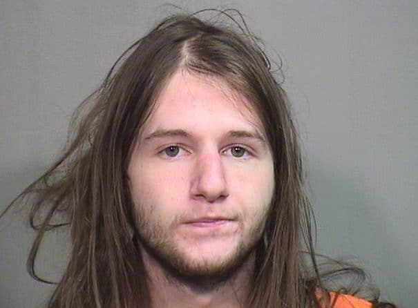 Man arrested after claiming he has COVID-19 then spitting, breathing on officers in McHenry