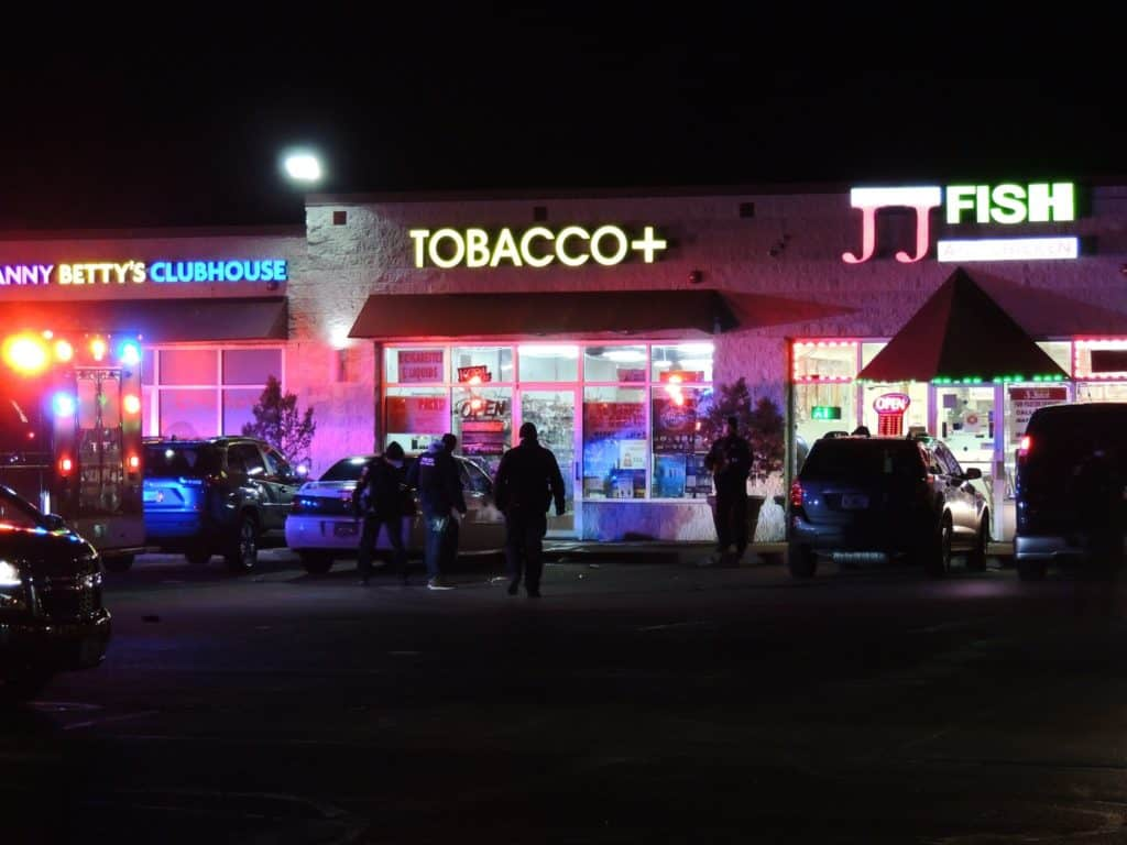 Woman shot in the head in front of Zion store; person of interest in custody