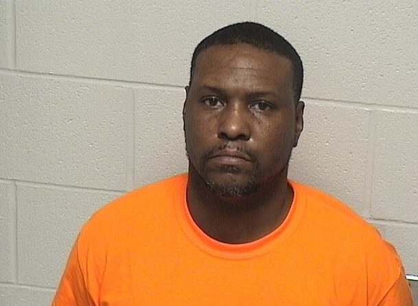 Man charged with shooting woman in the head in front of Zion store