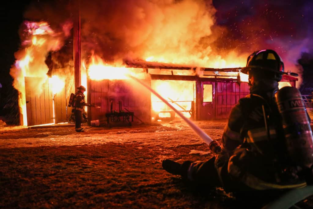 Animals escape without injury from fully engulfed barn fire near Woodstock