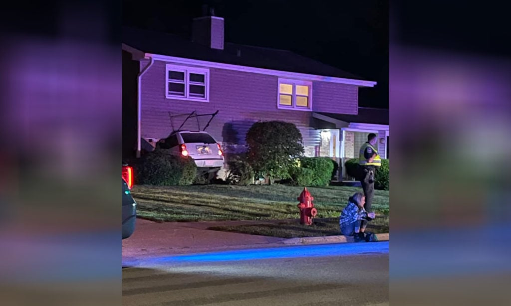 Driver trapped in vehicle after crashing through Crystal Lake home